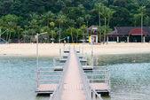 Peer to tropical beach — Stock Photo