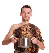 Wild man with cooked food in a stew pan — Stock Photo