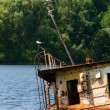 Wrecked abandoned ship on a river — Stock Photo
