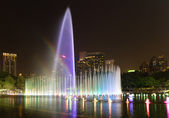 Illuminated fountain at night in modern city — Stock Photo