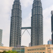 Stock Photo: Petronas Towers and Symphony lake in KualLumpur