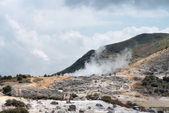 Smoking volcanic crater — Stock Photo
