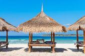 Three beach house on the sandy coast of blue sea — Stockfoto