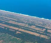 Blick vom flugzeug auf die feld-indonesien — Stockfoto