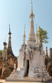 White ancient Burmese Buddhist pagodas  — Stock Photo