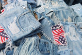 Heap of torn and frayed, threadbare jeans — Stok fotoğraf