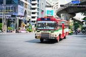 Public red bus on Bangkok street — Photo