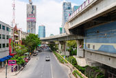 Skytrain BTS station and track under street in Bangkok, Thailand — Stock Photo