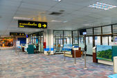 Departure terminal waiting hall with gates in airport — Stock Photo