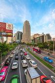 Traffic jam on a modern city in rush hour — Stok fotoğraf