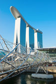 Marina Bay Sands and modern Helix bridge — Stock Photo