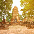 Ruins of old Buddhist temple with stupa and Buddha statues — Stock Photo #51421259