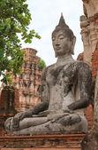 Buddha statue in meditate bhumisparsha mudra posture — Stock Photo