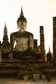 Buddha statue in old Buddhist temple ruins — Stock Photo