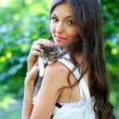 Stock Photo: Pretty young caucasigirl with kitten