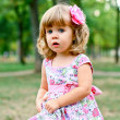 Caucasian little girl walking in the park — Stock Photo