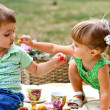 Caucasian little boy and girl eating sweets — Stock Photo #12760314