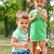 Stock Photo: Caucasian little boy and girl eating sweets