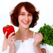 Smiling young woman with vegetables — Stock Photo