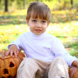 Portrait of a little boy with halloween pumpkins - Stock Photo