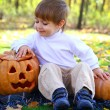 Portrait of a little boy with halloween pumpkins — Stock Photo