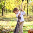 Little boy with haloween pumpkin and broom in woods — Stock Photo #13926982