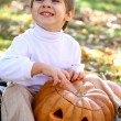 Little boy with halloween pumpkin — Stock Photo