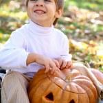 Little boy with halloween pumpkin — Stock Photo #13926999
