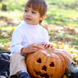 Portrait of a little boy with halloween pumpkin — Stock Photo