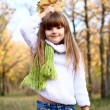 Stock Photo: Beautiful little girl with autumn leaves outdoors