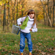 Little girl with a bucket in the autumn park — Stock Photo #14801285