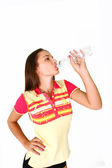 Fitness girl drinking water isolated on white background — Stock Photo