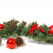 Christmas decorations and pine cones isolated on white backgroun — Stock Photo
