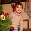 Happy little boy standing near the Christmas tree — Stock Photo
