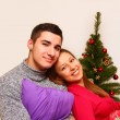 Smiling boy and girl with pillows and a Christmas tree isolated — Stock Photo