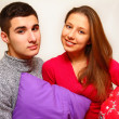 Smiling boy and girl with Christmas pillows isolated on white ba — Stock Photo