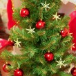 Decorated Christmas and New Year tree indoors — Stock Photo #15849709