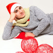 Young man in a Santa Claus hat with red balls isolated on white — Stock Photo #15930293