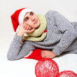 Young man with a scarf, hat santa claus and red balls isolated o — Stock Photo