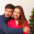 Royalty-Free Stock Photo: Young man and woman near the Christmas tree isolated