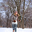 Happy young woman in a winter park outdoors — Stock Photo
