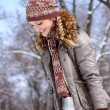Stock Photo: Happy young womwalking in winter park outdoors