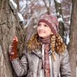 Portrait of girl in a winter park outdoors — Stock Photo #15931055