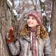 Portrait of girl in a winter park outdoors — Stock Photo