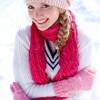 Portrait of happy girl on the snow - Stock Photo