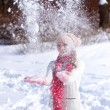 Stock Photo: Cute girl playing with snow outdoors