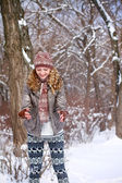 Happy young woman playing with snow outdoors — Stock Photo