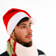 Young man with santa hat isolated on white background — Stock Photo
