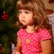 Cute baby with New Year or Christmas tree - Stock Photo