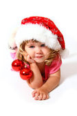 Smiling baby with a hat of Santa Claus and balls isolated on whi — Stock Photo